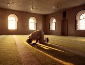 Muslim man prays